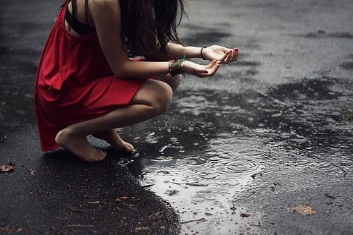 alone happy girl in rain