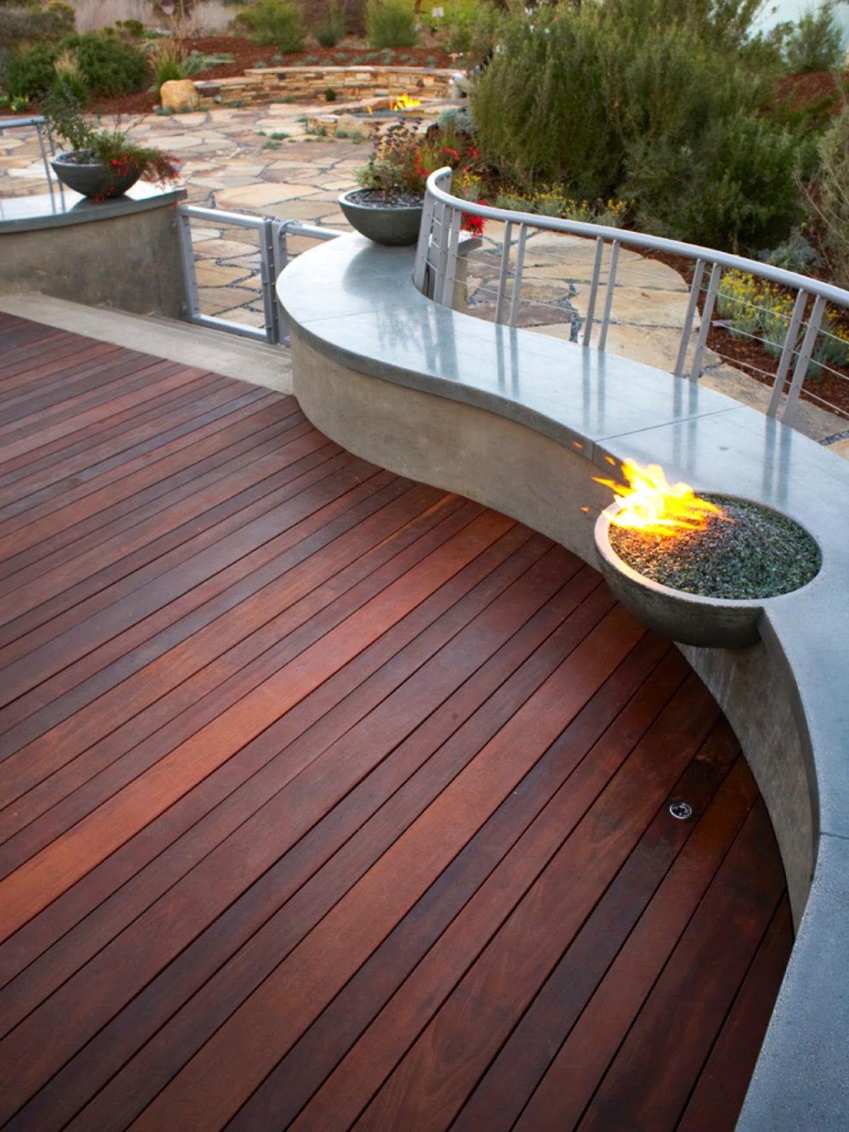Metal fire pit on wood deck - Seamless Patio Fire Pit Bench Design