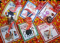 http://joyfuldaisy.com/free-downloadable-trick-or-treat-sucker-cards/