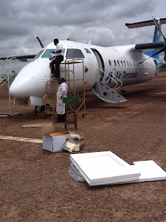 The aircraft undergoing repair in Kigoma