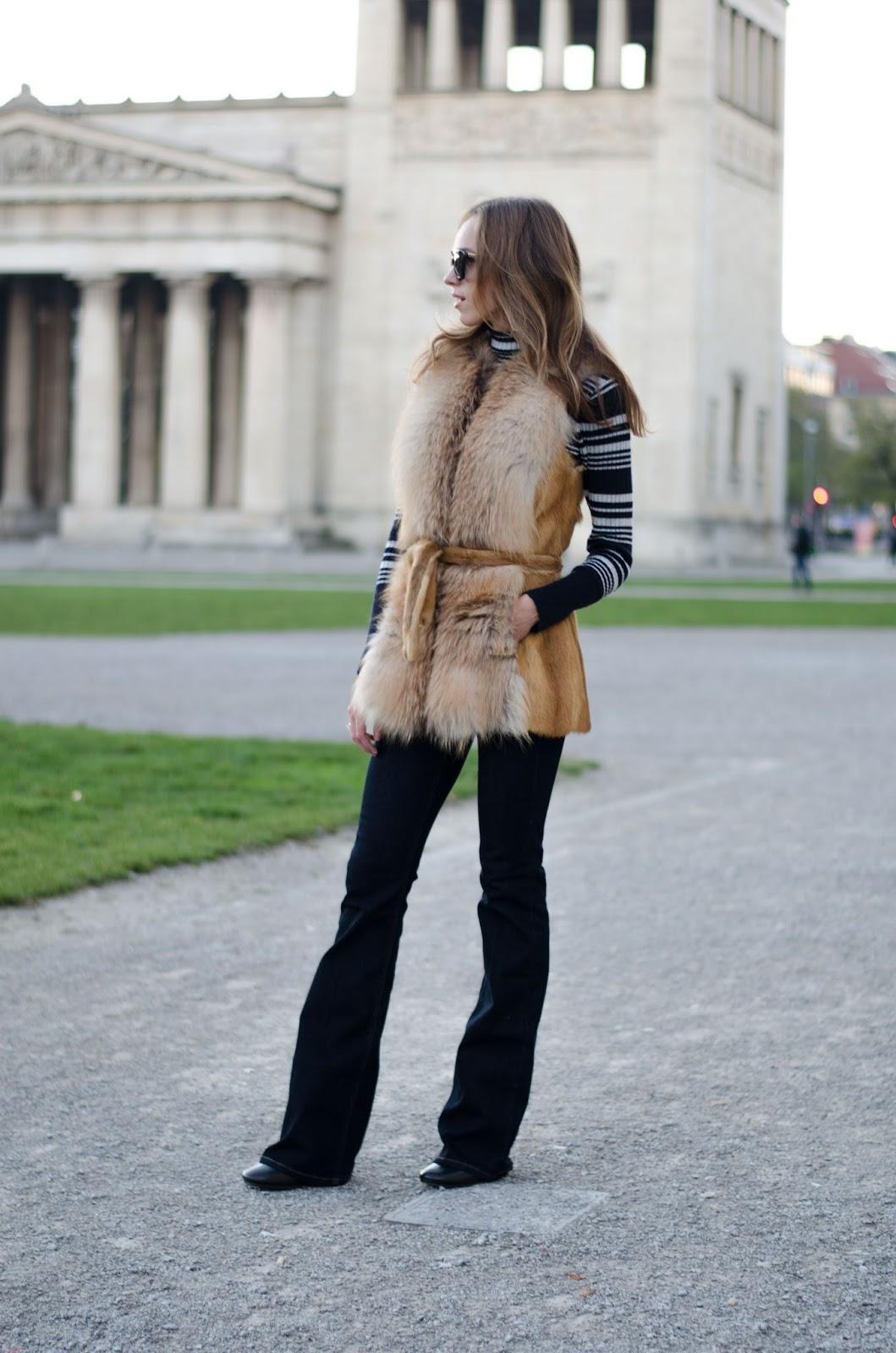 kristjaana mere flare jeans denim fox fur vest fall outfit inspo 70s