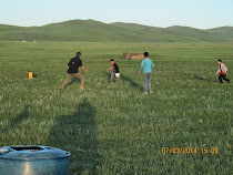 Playing soccer on the Mongolian steppes with Nypbda, Esenjan, Esenbek, and Nurlan at the homestead