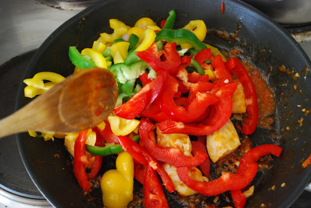 dice paprika green red yellow chicken spicy in the pan