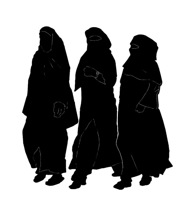 silhouettes of three women in burqas