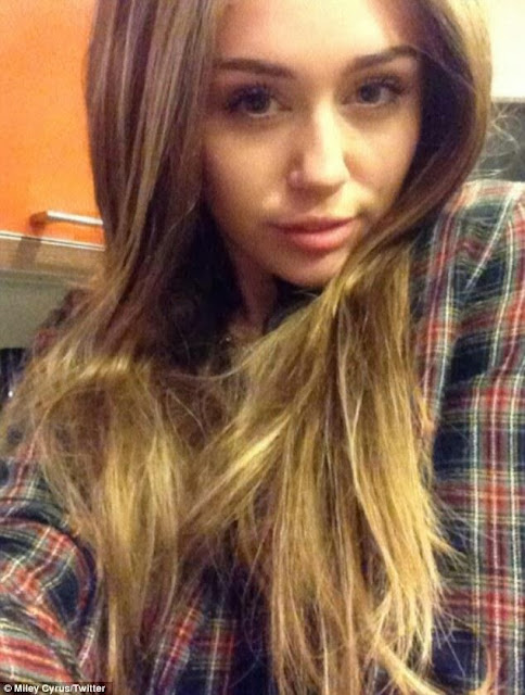 MILEY CYRUS TRIES PURPLE AND BLONDE ON TWITTER
