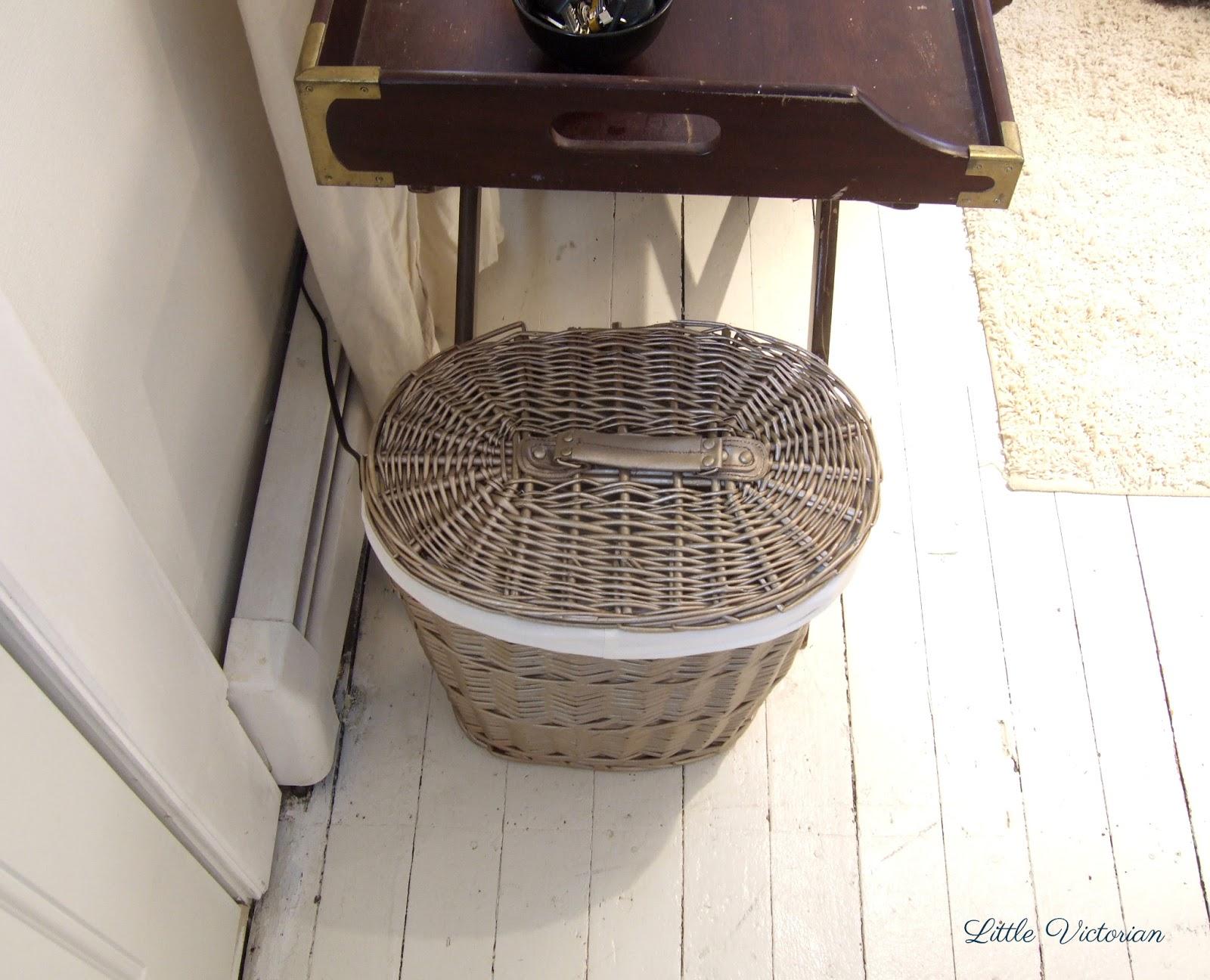 Painted wicker basket to hide paper shredder at front door | Little Victorian
