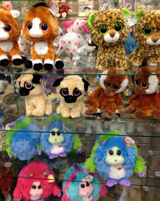 Shelves full of rounded, plush animals with huge round eyes