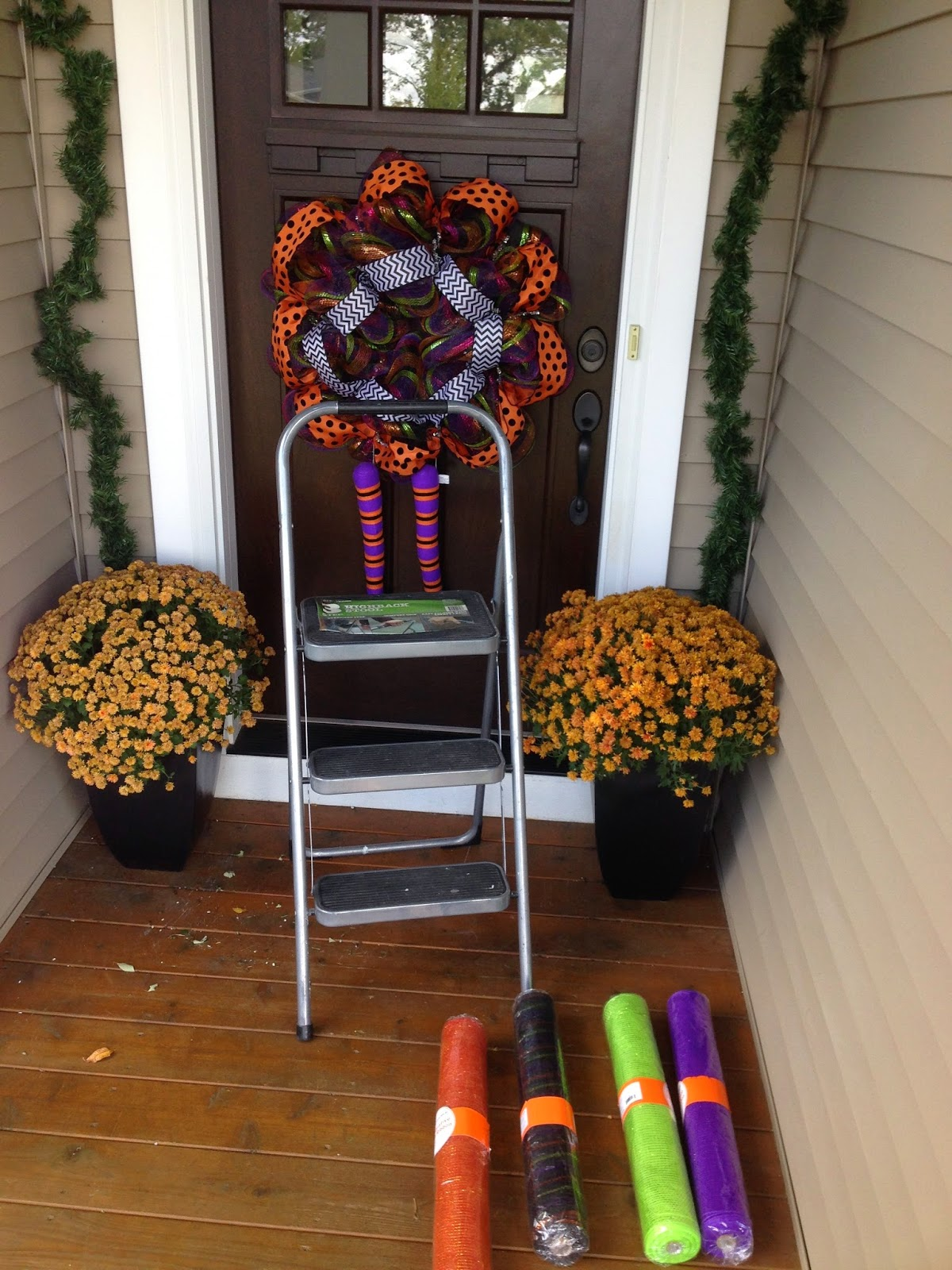 i ran to michaels and grabbed some garland with a coupon and put that up need something to tie the deco mesh onto - Deco Mesh Halloween Garland