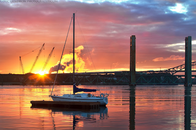 A colorful sunset and sailboat in portsmouth harbor