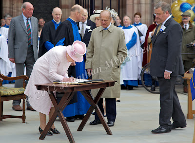 HM The Queen signing a book at Hereford Cathedral. Photo © Jonathan Myles-Lea