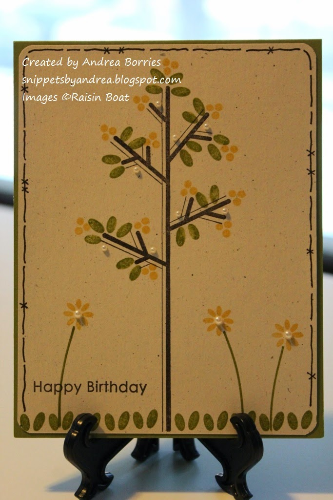 Birthday card with a stick-style tree with green leaves and yellow blossoms. Stamped grass and three flowers along the bottom of the card. The flowers and tree branches are embellished with small pearls.