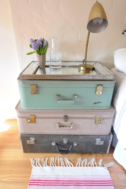 These stacked vintage suitcases work great as a nightstand.