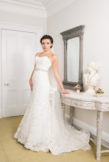 Model wears a bridal gown from Avorio Bridal for a wedding shoot