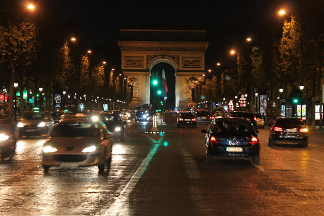 Arc de Triomphe was taken from the busy street of Avenue des Champs-Elysees in Paris, France
