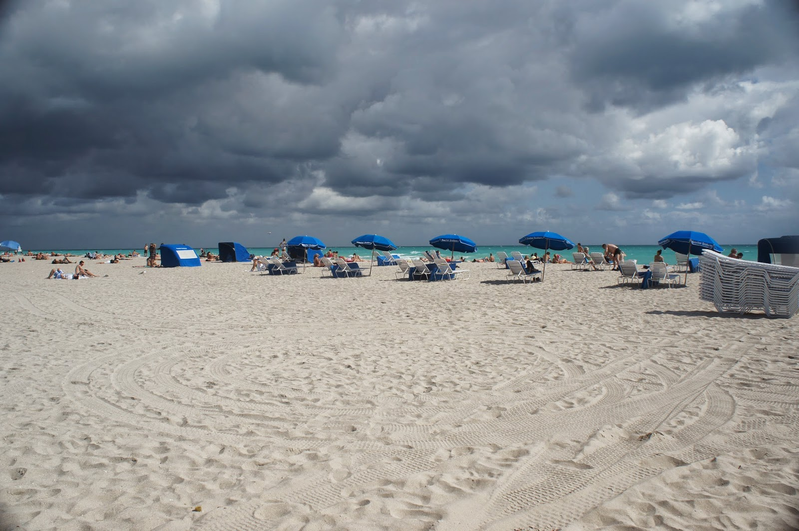 dark clouds above the beach with umbrellas