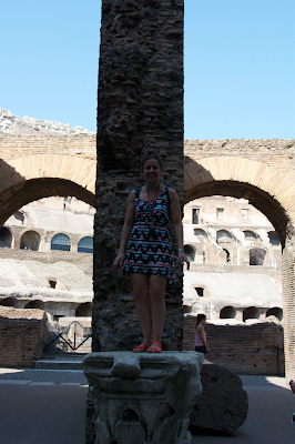 The Colosseum statue pose