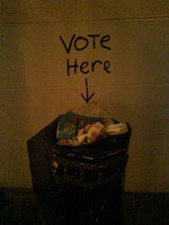 Trash can marked 'vote here'