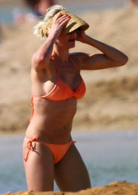 "Cameron Diaz shows off her muscle in ""Orange Bikini"""
