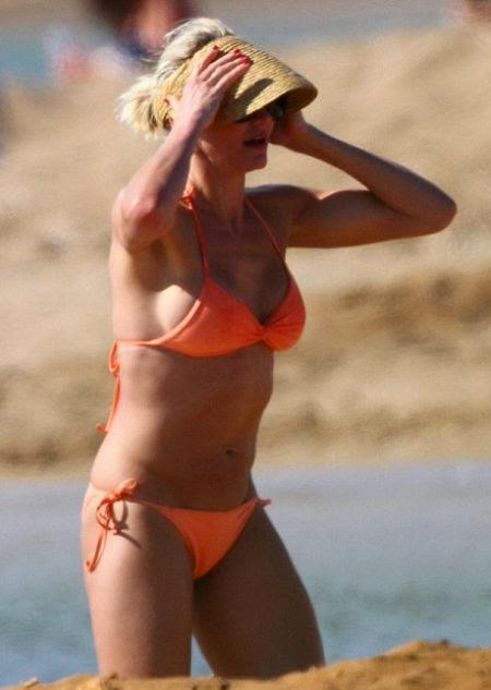 "Cameron Diaz shows off her muscle in ""Orange Bikini"""