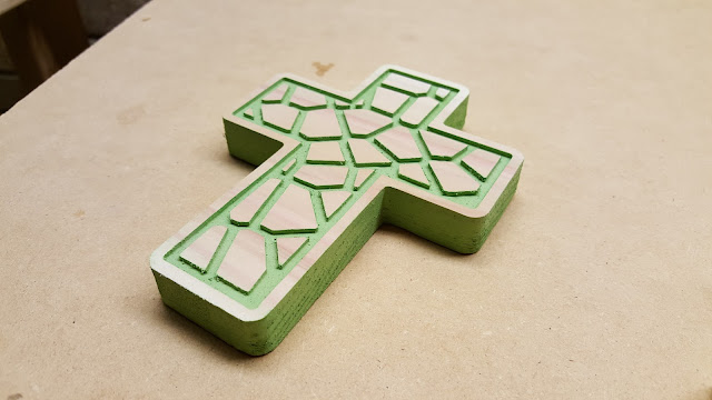 cross shaped cedar magnet with green voronoi pattern inlay