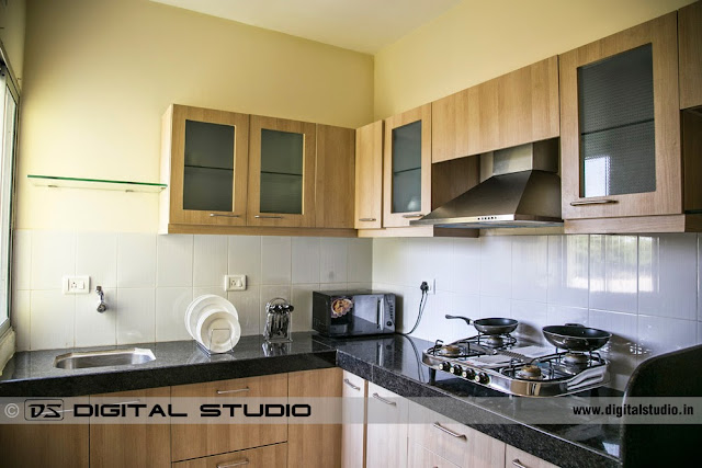 Complete kitchen setting with microwave oven