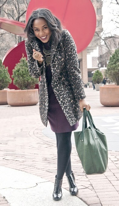 StyleUp  Go for a purple dress with a big necklace, printed coat and ankle boots.
