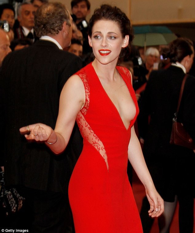Kristen Stewart almost falls out of her plunging red hot gown at ...