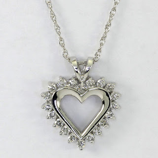 http://www.ebay.com/itm/Diamond-heart-pendant-14K-white-gold-round-brilliants-70CT-open-sweet-1-long-/121805356360?hash=item1c5c2a3d48