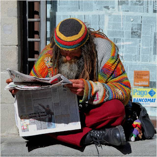 reading newspaper homeless man photo