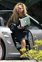 Rihanna getting out ogf her Porsche