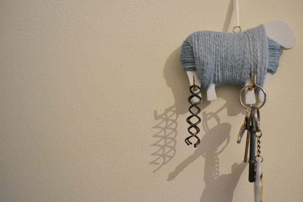 yarn covered sheep wall hook