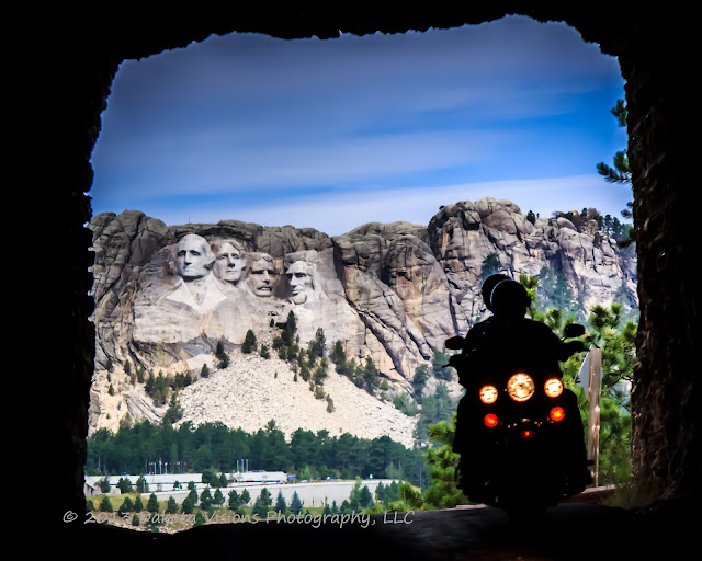 Sturgis Motorcycle Rally 2013 Image of Motorcycle Riding Through Tunnel with Mt Rushmore Behind by Dakota Visions Photography LLC