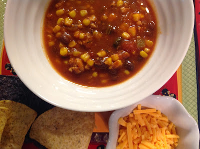 Chicken, Black Bean, and Corn Chili served with Cheese, Sour Cream, and Chips