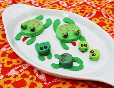 http://www.creativejewishmom.com/2011/03/recycled-bottle-cap-and-plastic-lid-frogs.html