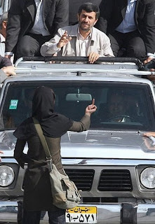 funny picture: iranian woman with middle finger for Ahmadinejad