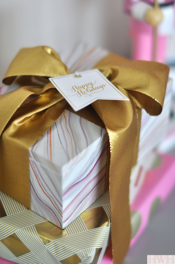 Pretty holiday packages with gold bow and sugar paper gift tags | Honey We're Home