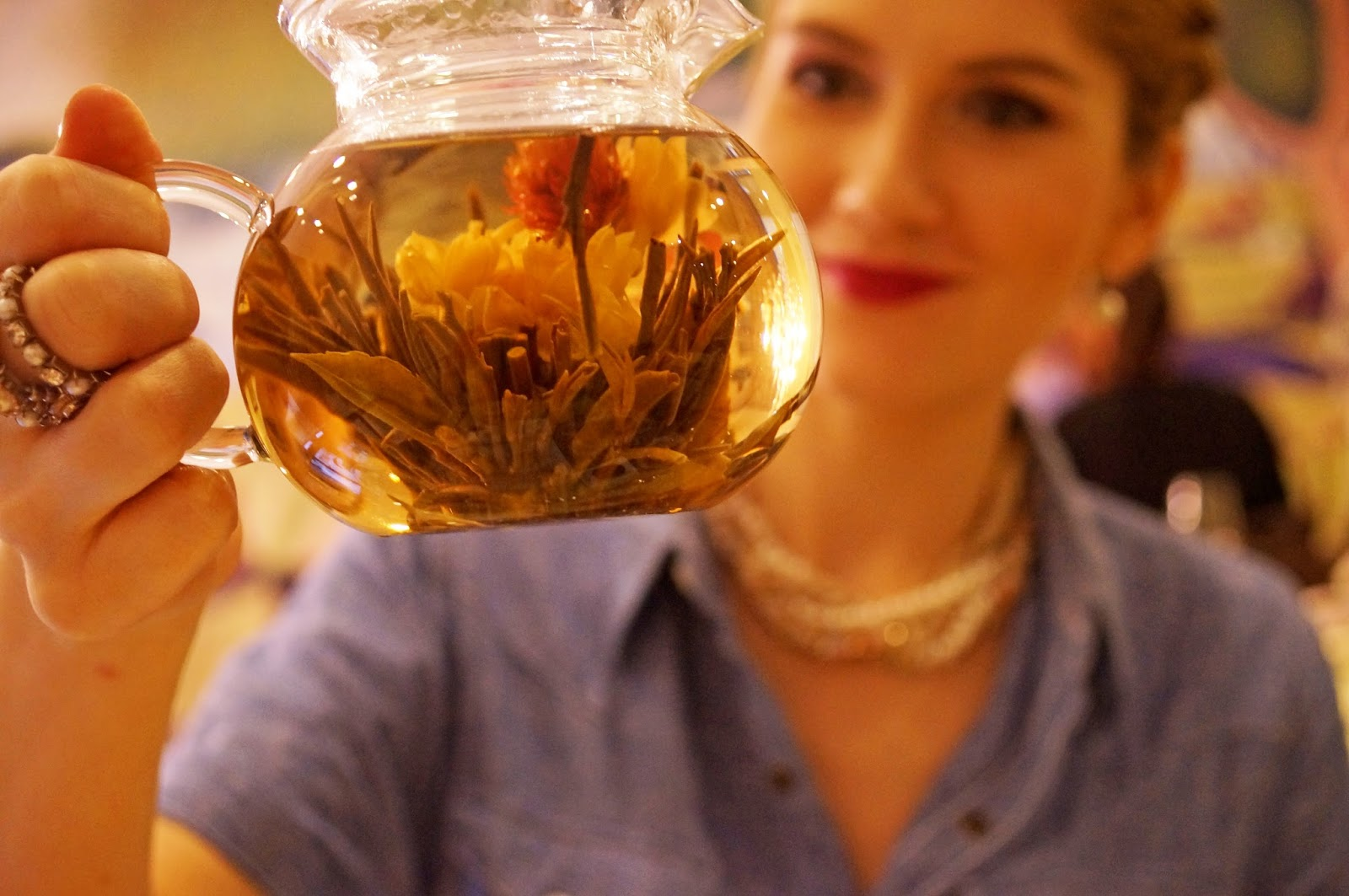 This flower blooms and releases the tea into your tea pot! Awesomeness!