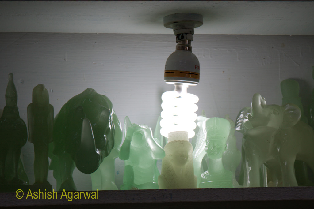 A CFL lamp in the middle of a number of Jade statues in an exhibit in the Valley of the Kings