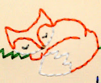 Sleeping Fox Stitchery
