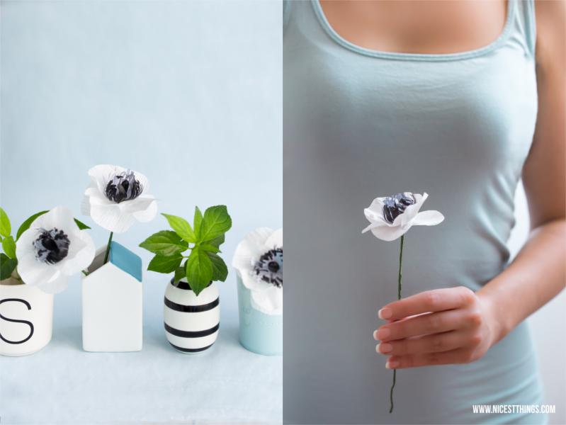 Blumen in vielen kleinen Vasen