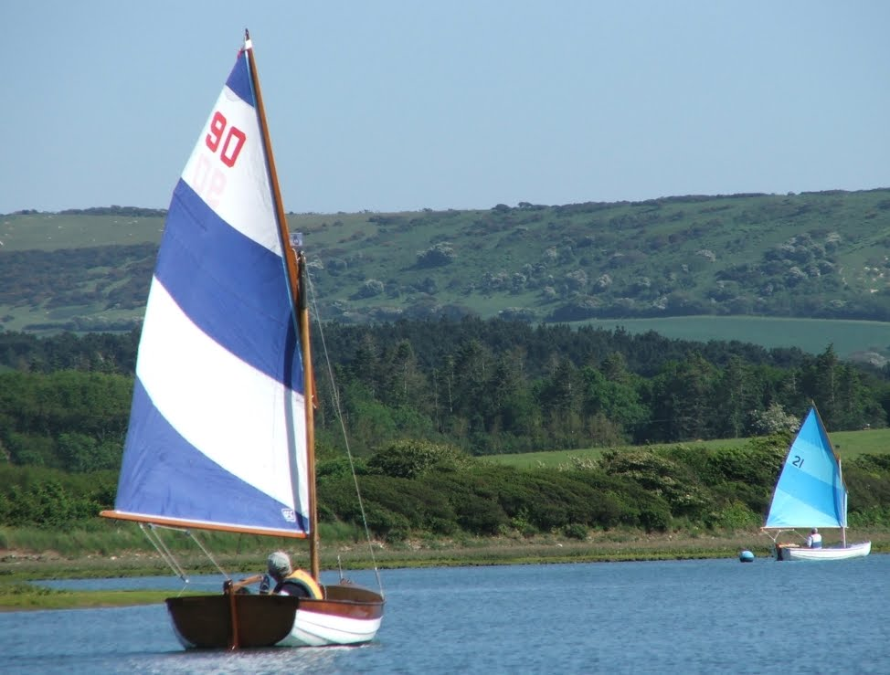 During the 1950's Scows were still being raced and used as yacht tenders, ...