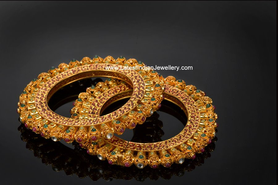 Traditional Gems Studded In Contemporary Designed Gold Bangles