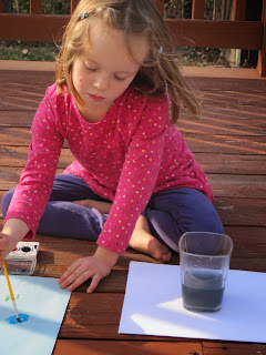 Mabel painting on the deck