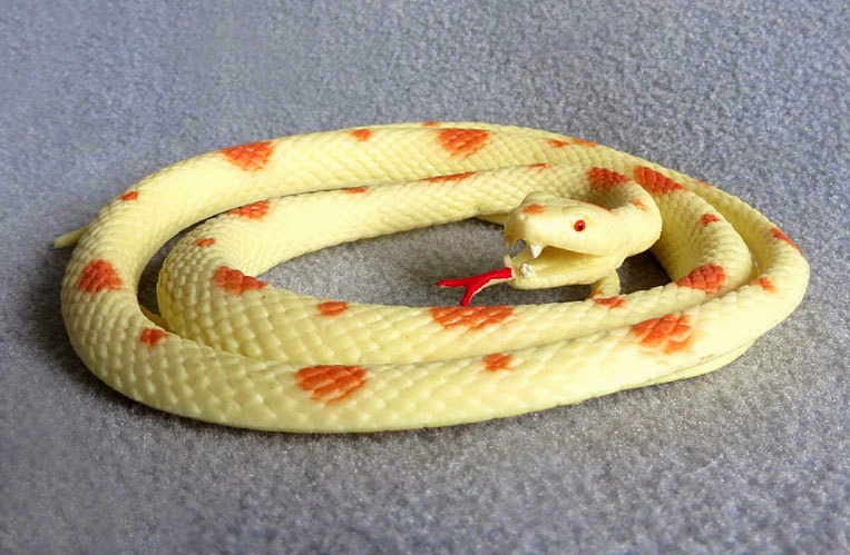 Toy Cream and Orange-Colored Snake