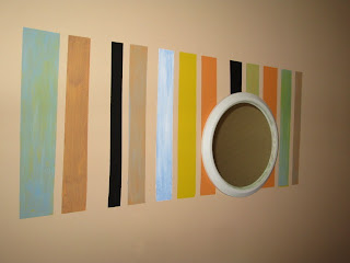 stripes painted on a wall mirror