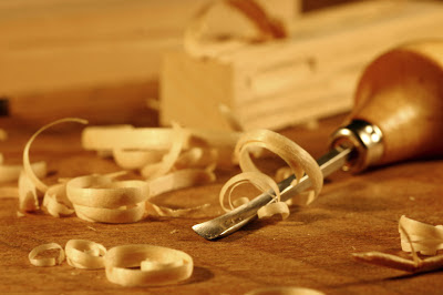 of wood shavings a woodworking tool and piece of wood via woodworking ...