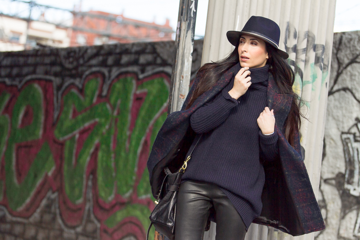 Fashion blogger with navy and black hat with zip by Zara
