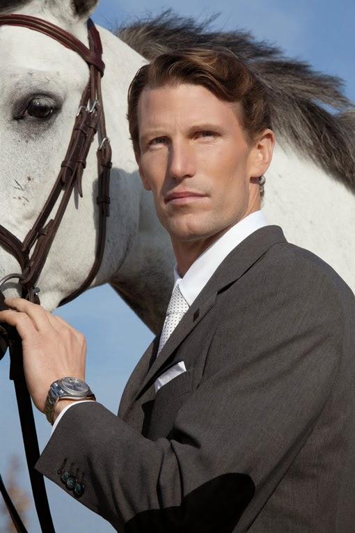 prydligt klädd man med häst