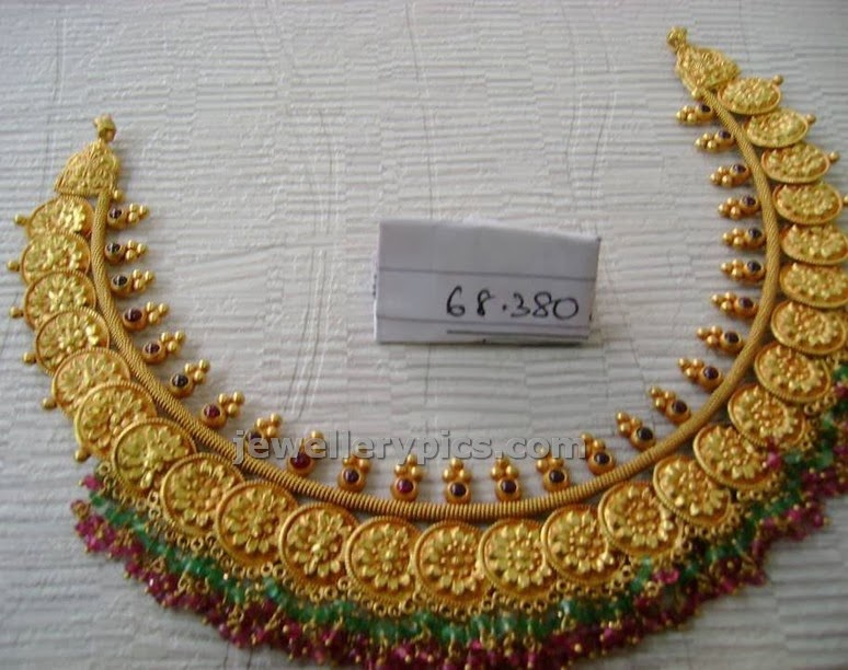 gold kasumala or short antique kasulaperu in floral design from varakrupa jewelelrs