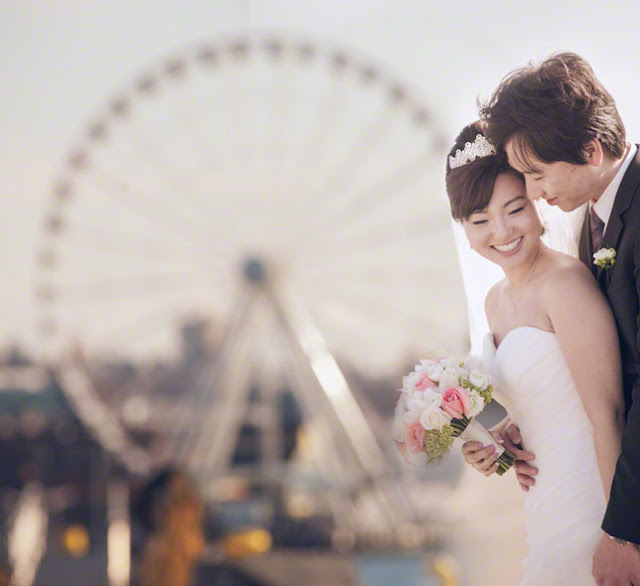 wedding couple laughing at The Great Wheel Seattle, wedding photos at seattle great wheel